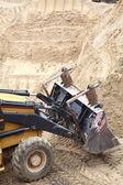 Cantiere edile escavatore giallo — Foto Stock