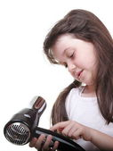 Little girl posing with hair dryer — Stock Photo