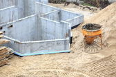 Construction building site pouring concrete in form sand — Stock Photo