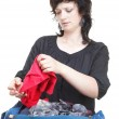 Woman crammed full of clothes and shoulder bag isolated — Stock Photo #13014826