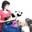 Woman and daughter hand crammed full of clothes and shoulder bag — Stock Photo #13015909