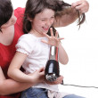 Woman and daughter Little girl dries hair isolated — Stock Photo #13016400