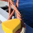 Stock Photo: Port detail and ship to fasten mooring rope to bollard