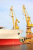 Yellow port crane terminal seaport — Stock Photo