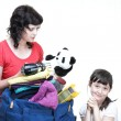 Stock Photo: Womand daughter hand crammed full of clothes and shoulder bag