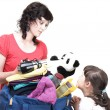 Stock Photo: Woman and daughter hand crammed full of clothes and shoulder bag