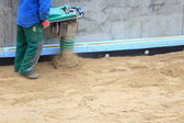 Worker at site working with compress tool - sand — Foto Stock