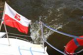 Poland Polish Ensign Flag on yacht sea — Stock Photo