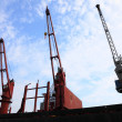 Stock Photo: Red port crane terminal seaport