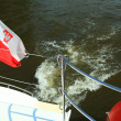 Poland Polish Ensign Flag on yacht sea — Stock Photo #14137537