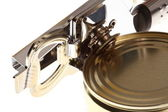 The can opener opens can — Stock Photo