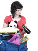 Woman and daughter hand crammed full of clothes and shoulder bag — Stock Photo
