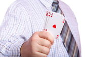 Man and playing cards in hand — Stock Photo