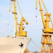 Stock Photo: Yellow port crane terminal seaport