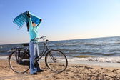 Woman and shawl at sea shore — Stock Photo