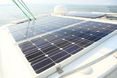 Solar Panels charging batteries aboard sail boat — Stock Photo