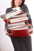 Woman holding stack of folders - Isolated — Stock Photo