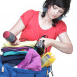 Woman packing bags - Stock Photo