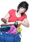Woman packing bags — Foto de Stock