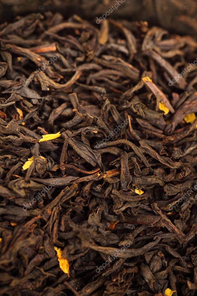 Black Tea background, texture dry leaves, tea scented with bergamot oil Macro background — Stock Photo #21231805