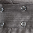 Royalty-Free Stock Photo: Button on a gray suit