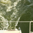 Stock Photo: Bow of ship creates wake water