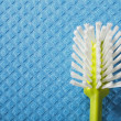 Blue sponge background and brush — Stock Photo