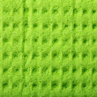 Green sponge foam as background texture — Stock Photo