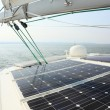 Solar Panels charging batteries aboard sail boat - Stock Photo