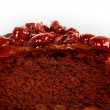 Piece of chocolate cake with icing and cherry — Stock Photo