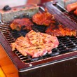 Grilled sausages and meat on the barbecue — Stock Photo