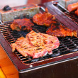 Grilled sausages and meat on the barbecue — Stock fotografie