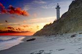 Rocky beach at sunset — Stock Photo