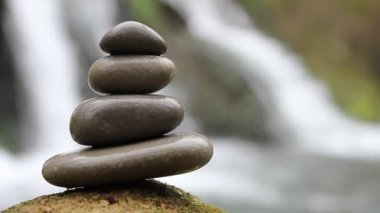 Stacked zen stones and waterfall — Stock Video