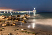 Bridge in sea at night — Stock Photo