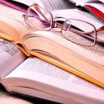 Eyeglasses on open books — Stock Photo #7209964