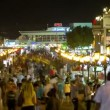 Crowded shopping street - Stock Photo