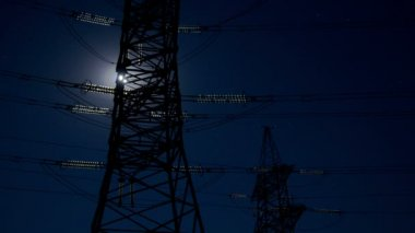 Electricity pylon and moon. — Stock Video