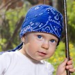 Boy in swing — Stock Photo