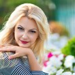 Beautiful blonde in the garden — Stock Photo