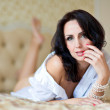 Beautiful woman lying on the bed — Stock Photo #12323032