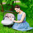 Young mother and newborn in the park — Stock Photo