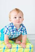 Cute baby sitting on the floor — ストック写真