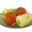 Two bell peppers and two tomatoes — Stock Photo