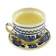 Handpainted cup and saucer isolated on white — Stock Photo