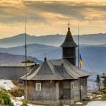Wooden church in mountain — Stock Photo