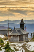 Wooden church in mountain — Stock Photo