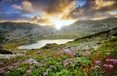 Mystic mountain sunset with lake in autumn — Stock Photo