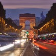 Traffic in Paris, Arc de Triomphe — Stock Photo #14069689