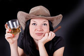 Girl in a hat with a cigar and whiskey — Stock Photo
